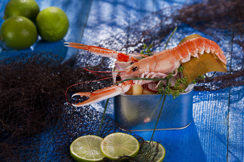 Crustacean canned. Presentation of a crustacean with mixed vegetables in box stock photography
