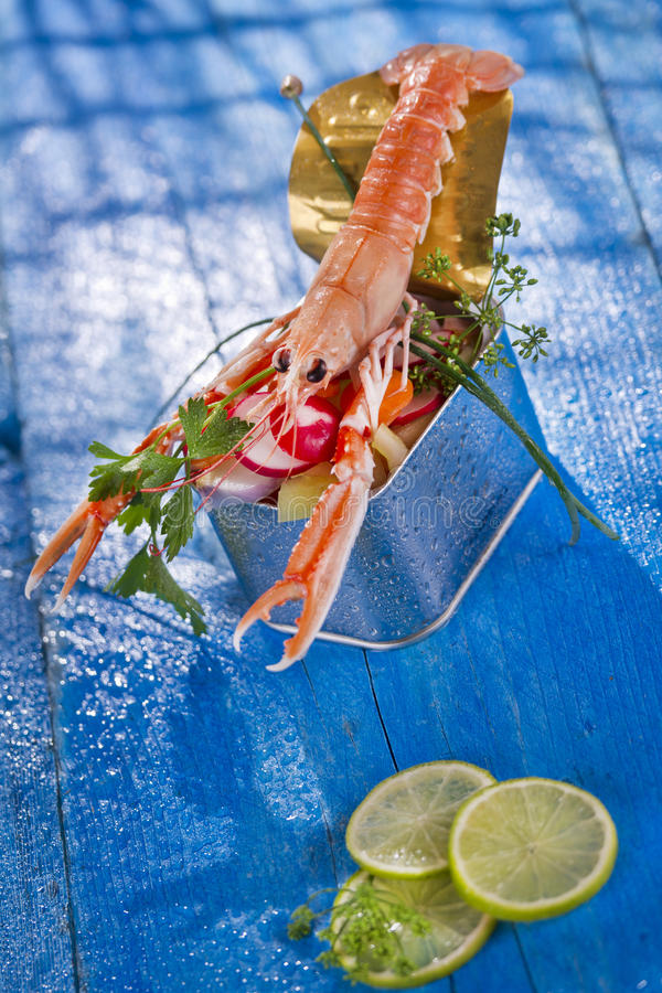Crustacean canned. Presentation of a crustacean with mixed vegetables in box stock images