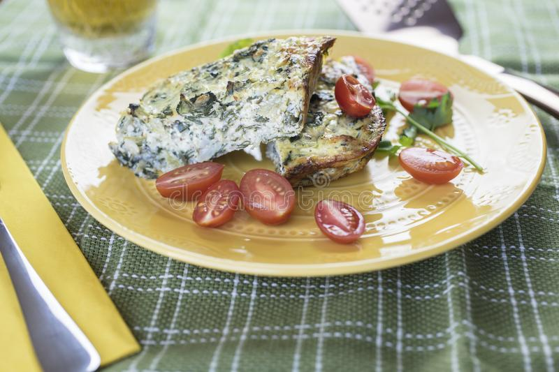 Crustless Chard Quiche Served With Tomatoes stock photos