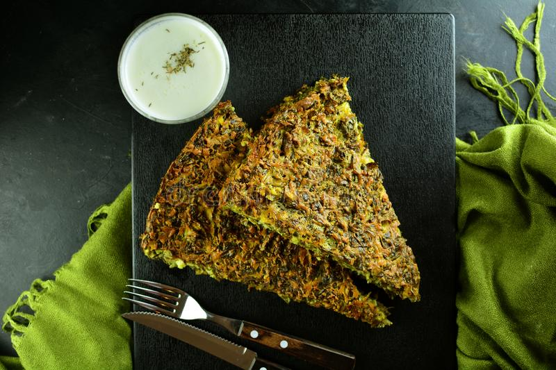 Crustless Keto Spinach Pie with Cheese. Homemade low-carb keto spinach pie with eggs, cheese and almond flour stock photo