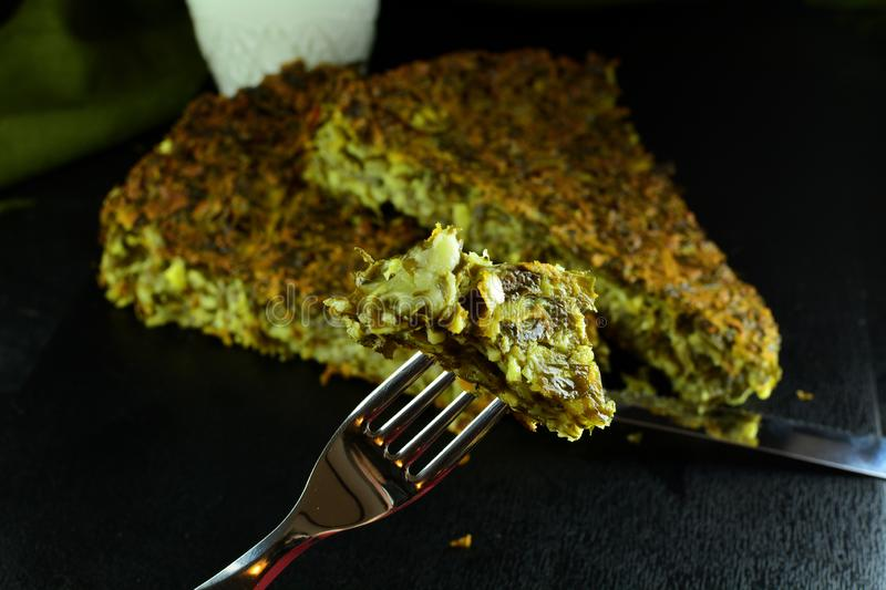 Crustless Keto Spinach Pie with Cheese. Homemade low-carb keto spinach pie with eggs, cheese and almond flour royalty free stock photography