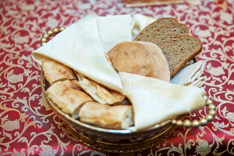 Chopped bread in a copper bowl royalty free stock photography