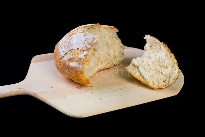 Crusty Italian bread on peel stock photo