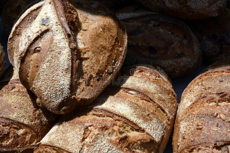 Crusty Loaves of Artisan Bread at a Farmers Market royalty free stock images