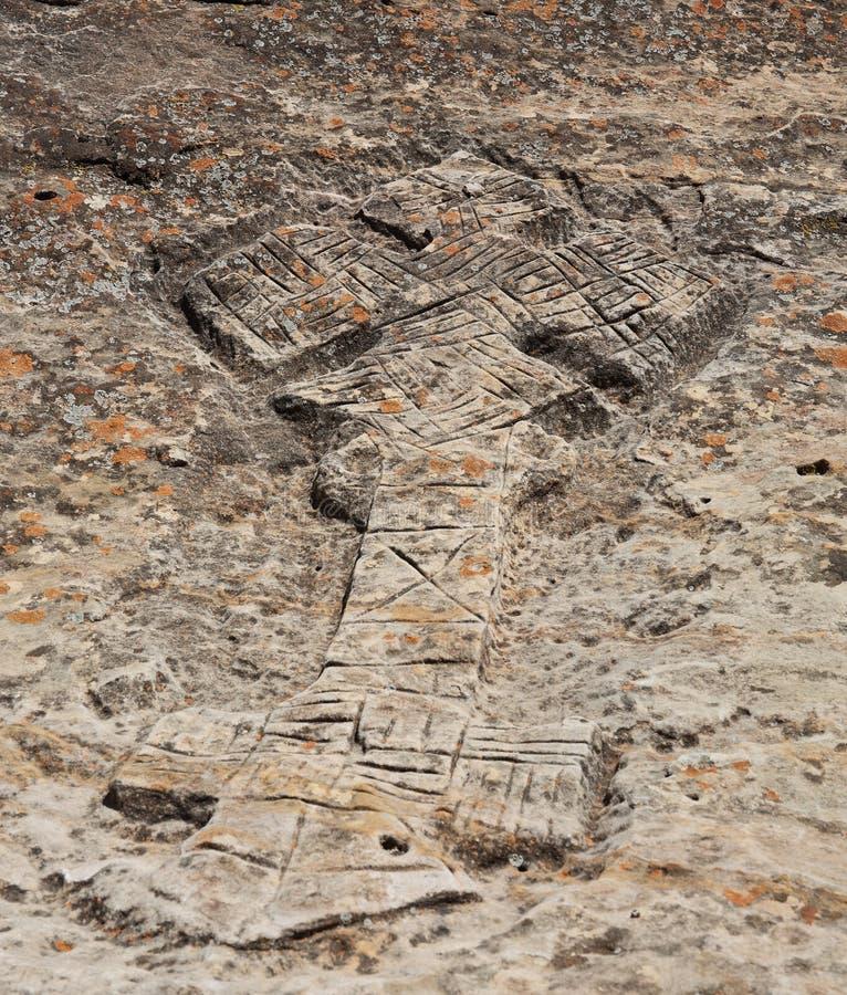 Cruz cristiana etíope cortada roca fotos de archivo libres de regalías