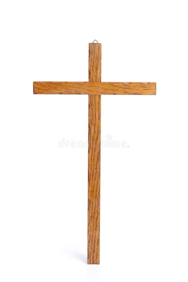 Cruz de madera en un fondo blanco imagen de archivo