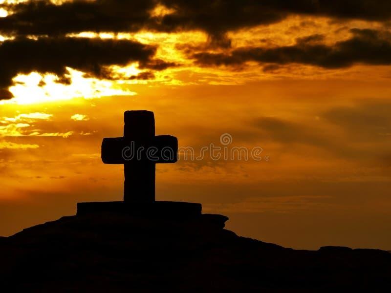 Cruz en la puesta del sol 1 imagenes de archivo