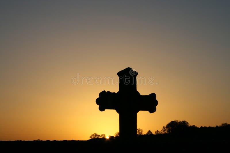 Cruz en la salida del sol fotos de archivo libres de regalías