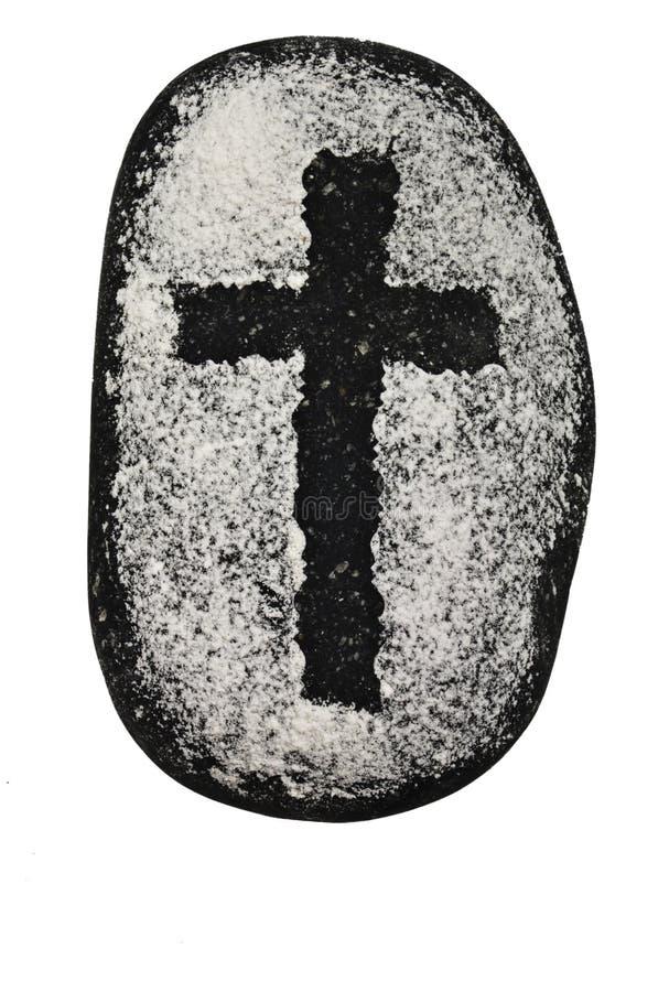 Cruz negra en roca fotografía de archivo libre de regalías