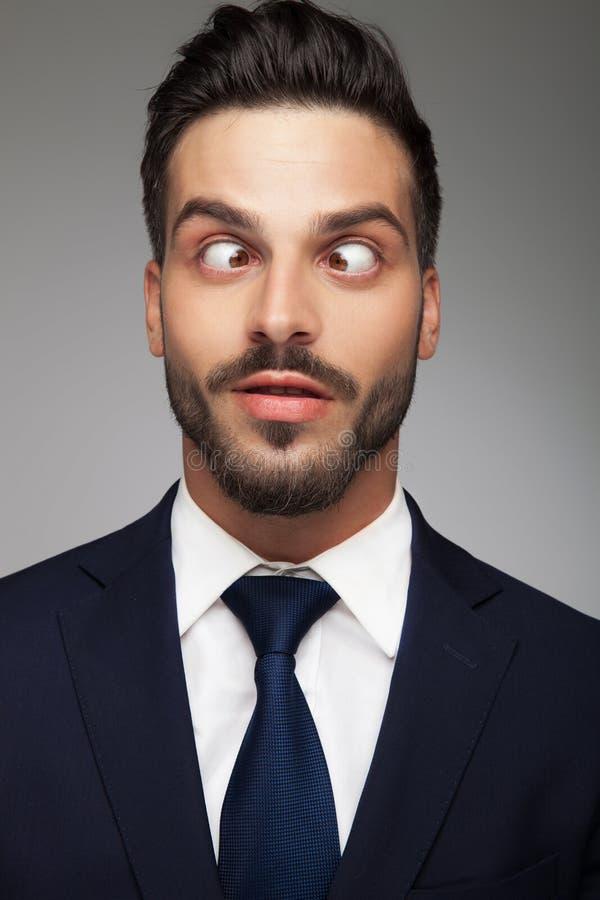 Cruz nova sorriso eyed do homem de negócio foto de stock royalty free