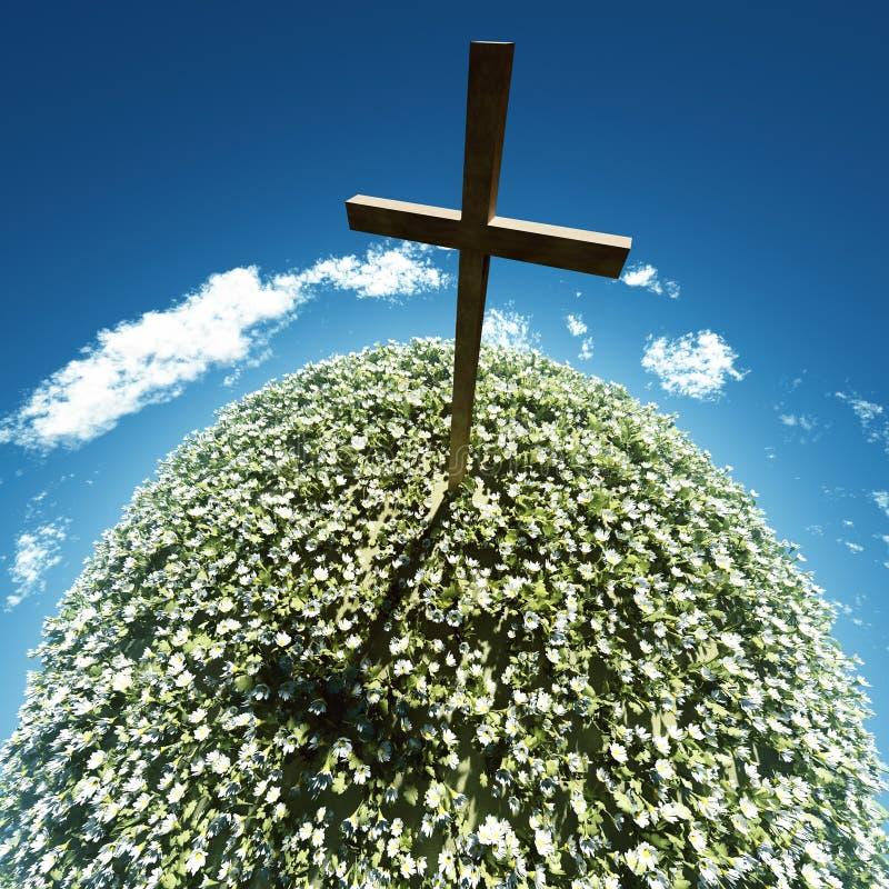 Cruz rodeada por las flores fotos de archivo libres de regalías