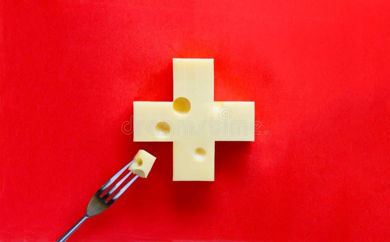 Cruz suíça no formulário do queijo fotos de stock royalty free