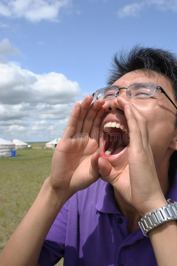 Cry. A cried Asian man on the grassland royalty free stock photos