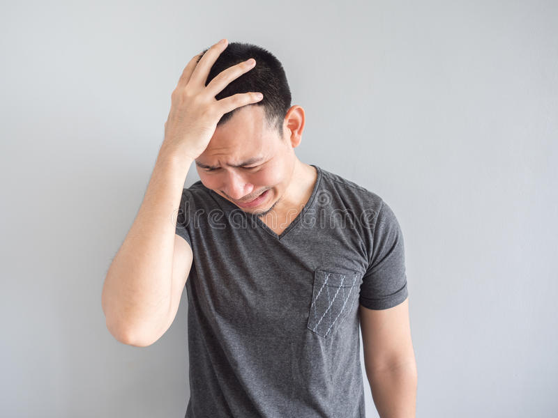 Cry asian man in black t-shirt. Crying asian man in black t-shirt royalty free stock image