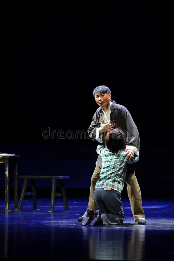 Cry on each other's shoulder- Jiangxi opera a steelyard. Jiangxi opera a steelyard is adapted from a true story: the last century fortys, the protagonists father stock photos
