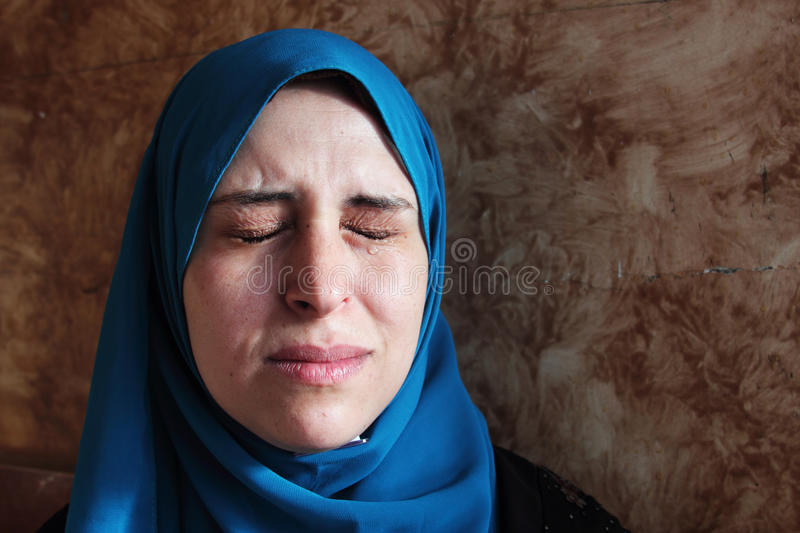 Crying arab muslim woman. Arabian egyptian muslim woman crying and feeling sad stock photography
