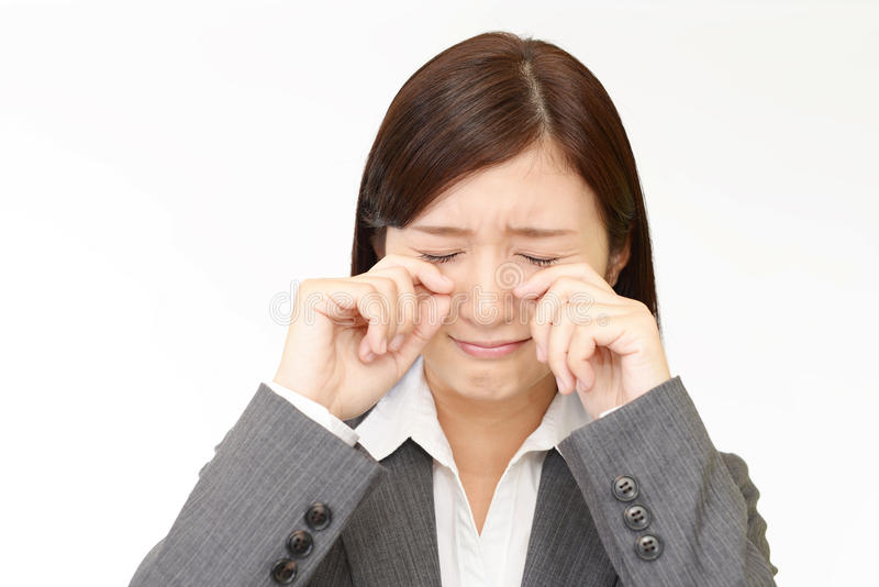 Crying Asian business woman stock photography