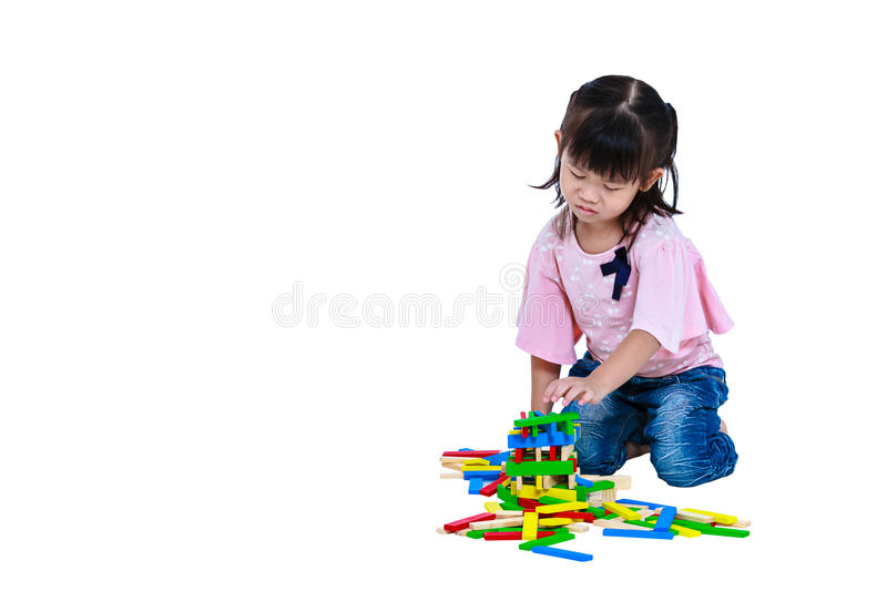 Crying asian child playing toys and seem unhappy. Isolated on white background. stock images