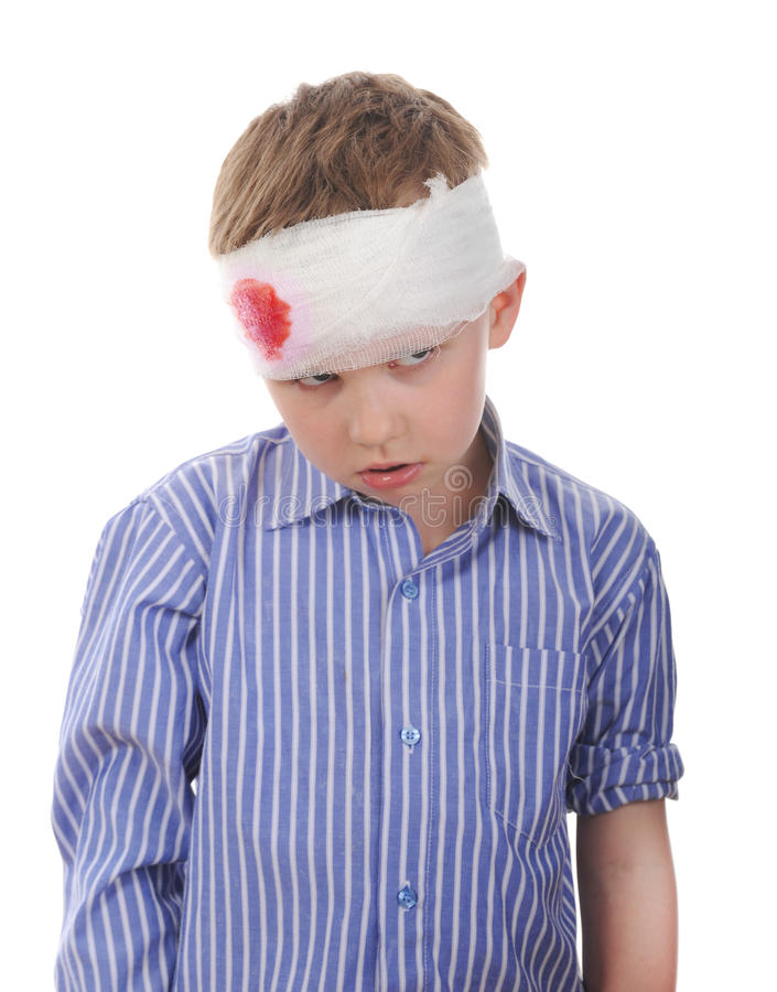 Crying boy with a bandaged head stock images