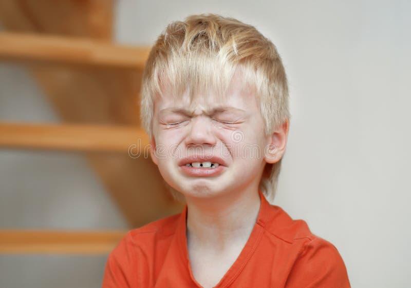 Crying boy stock image