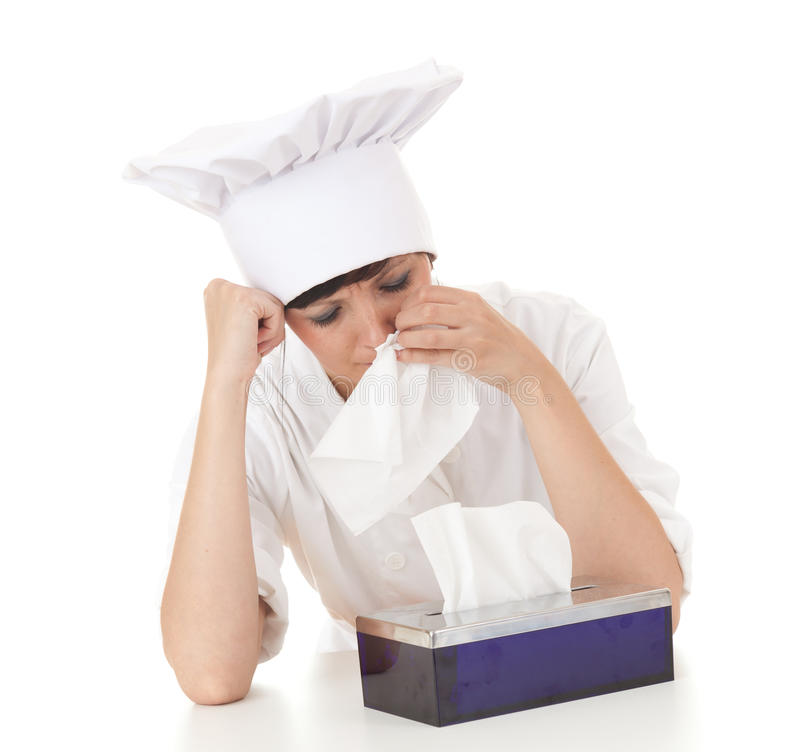 Crying cook woman with tissues