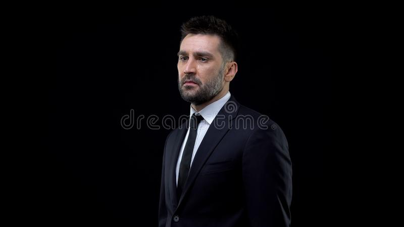 Crying desperate businessman black background, life crisis, mental exhaustion. Stock photo royalty free stock photo