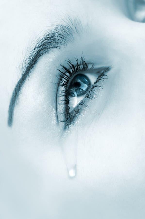 Crying eye, blue highkey version stock image