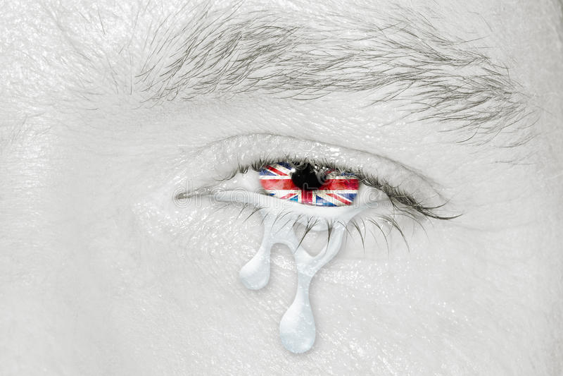 Crying eye with United Kingdom Flag stock photos