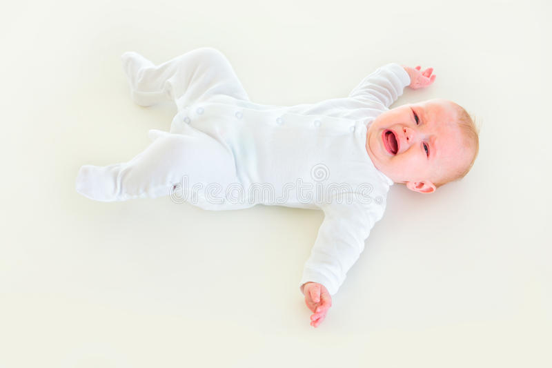 Download Crying Four Month Old  Baby Laying On Back Stock Image - Image: 19997687