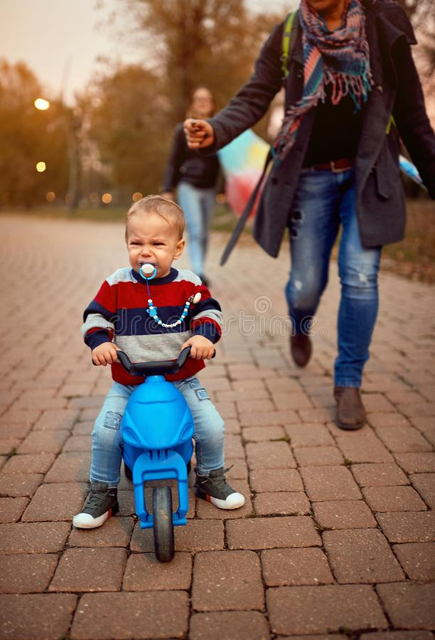 Crying boy with mother at the autumn park together royalty free stock images