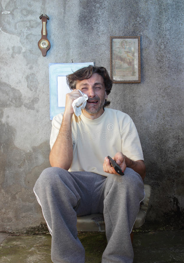 Crying man with remote control royalty free stock photo