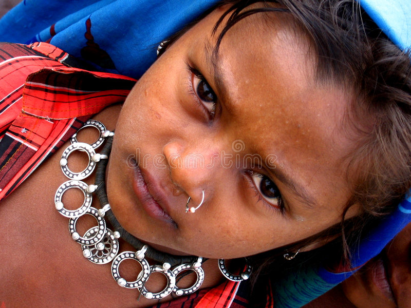 Crying for money. A little girl with a beautiful antique cries as she begs for money in India royalty free stock photos