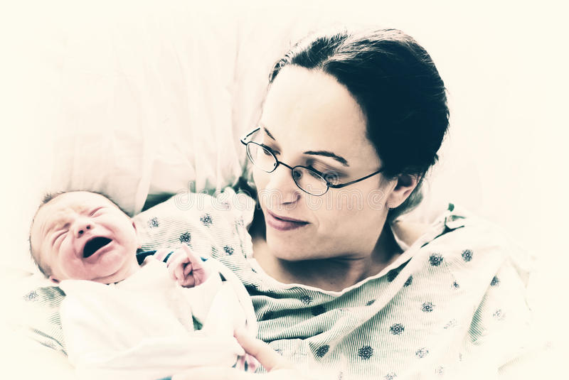 Crying Newborn with Mother stock image
