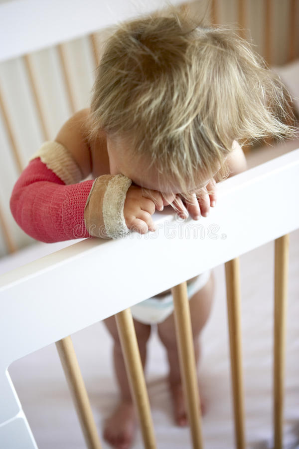Crying Toddler With Arm In Cast Stock Image