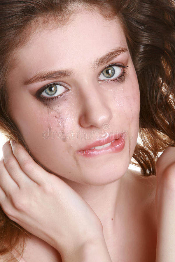 Crying woman with flowing make-up. Close-up portrait of a crying woman with flowing make-up stock images