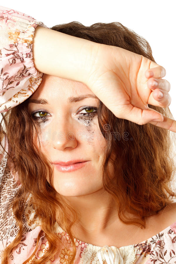 Crying woman with smeared mascara royalty free stock images