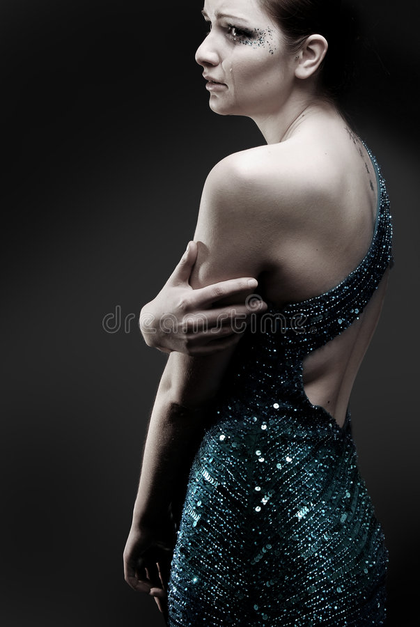 Crying woman in sparkly dress stock images
