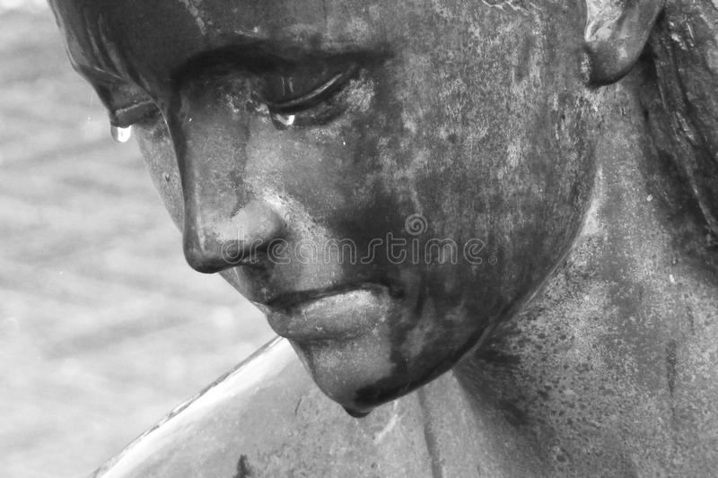 Crying young girl statue stock photography