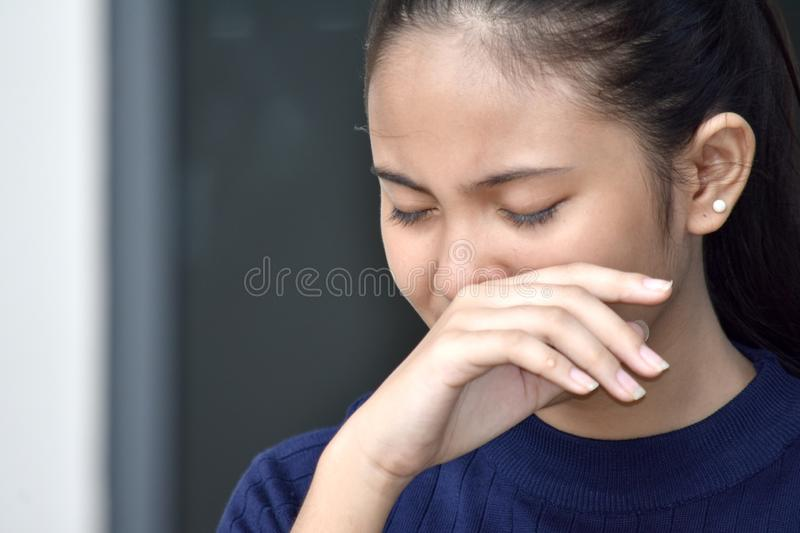 Crying Youthful Girl. A young pretty asian teenage girl royalty free stock image