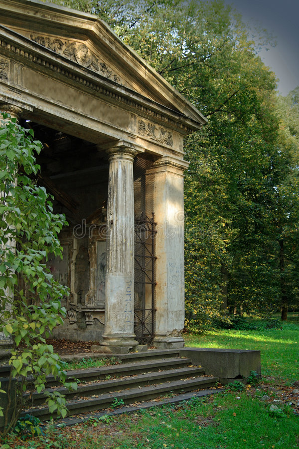 Crypt. Old crypt entrance in the forest stock photography