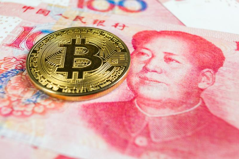 Crypto currency concept - A Bitcoin with Chinese currency RMB, Renminbi, yuan stock photo