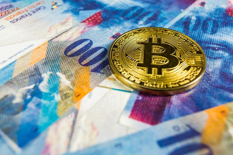 Crypto currency concept - A Bitcoin with Swiss franc currency, Switzerland. Photo of Crypto currency concept - A Bitcoin with Swiss franc currency, Switzerland stock images