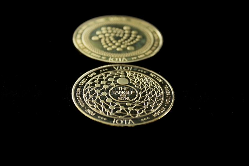 Crypto currency digital coin - iota front and back royalty free stock image
