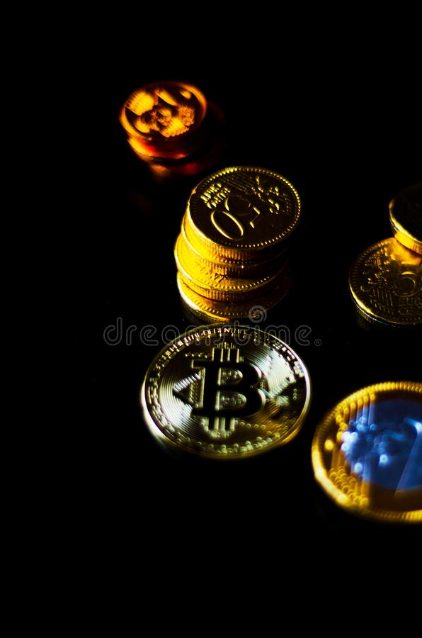 Crypto currency Gold Bitcoin with chocolate euro, BTC, macro shot of Bitcoin coins on black background stock photo