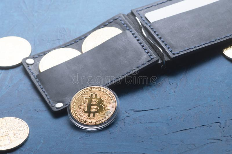 Crypto-currency: Leather wallet with metal bitcoin coins. Close-Up stock image