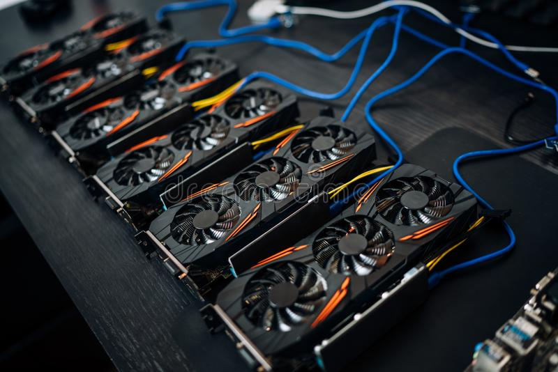 Crypto currency mining components with graphics cards and gpu. Internet connected power rig mining ethereum, bitcoin and altcoins. Crypto currency mining royalty free stock image