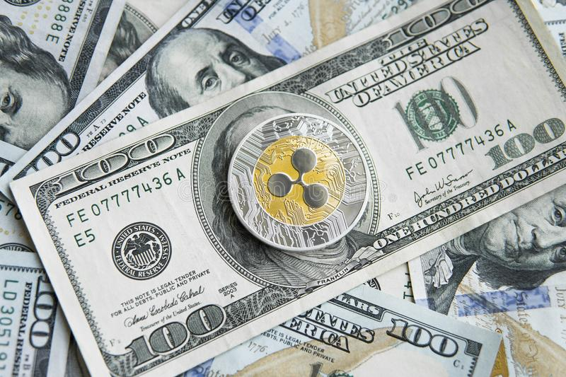 Crypto currency ripple xrp and us dollars money background. Blockchain and cyber currency. Global money. Exchange. Bussiness, commercial. Cash money and royalty free stock images