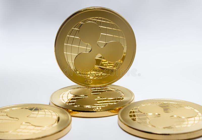 Crypto digital currency - gold coins ripple xrp. On a black and white background are gold coins of a digital crypto currency - ripple xrp. In addition to the stock image