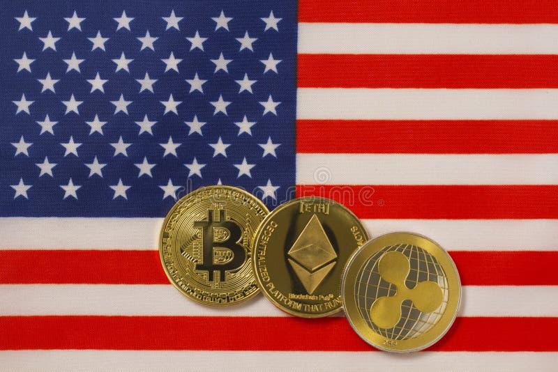 Crypto valutametallmynt med amerikanska flaggan arkivbild