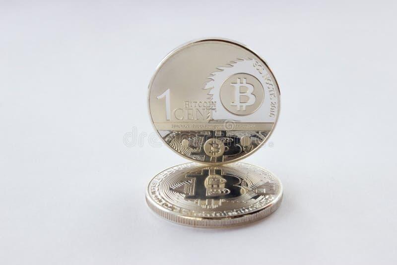 Crypto valutor en cent och bitcoin på en vit bakgrund royaltyfri bild